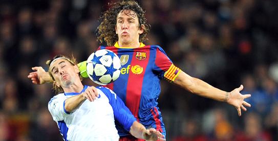 e212df0b456 Barcelona's captain Carles Puyol (R) vies with Copenhagen´s Cesar Santin  (L) during their Champions League football match.