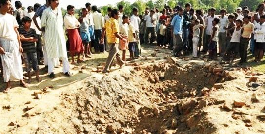 At UN, groups cite gains against land mine deaths