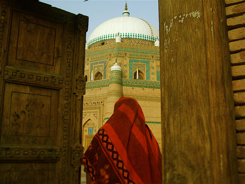 ENTERING THE SHAH RUKN-E-ALAM'S DARBAR<br /> Shah Rukn-e-Alam's Tomb, Multan, Punjab<br />  The tomb of the Sufi saint Shah Rukn-e-Alam (The pillar of the world) was built between 1320 and 1324. This octagonal building rises to a height of 30.5 metres and has an internal diameter of 16 metres. The dome, said to be the second largest in the world, has a diameter of 17 metres. The exterior of the Mausoleum is made of red bricks, embellished with glazed tile panels, string courses and battlements.<br />   Photographer