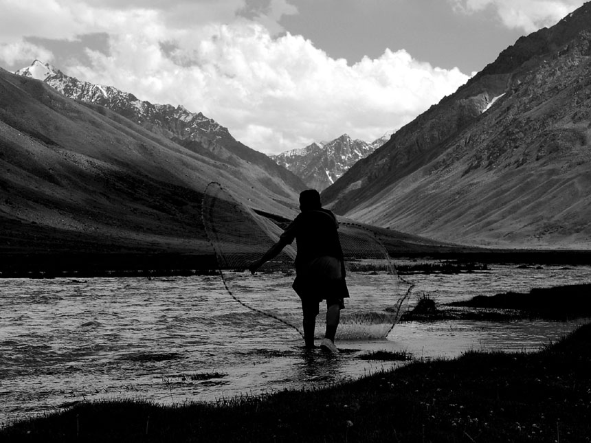 MOUNTAIN FISHERMAN<br /> Chitral District, Khyber Pakhtunkhwa<br />  A local man throws a net into the glistening waters of the Chitral River, which is well known for trout fishing. Chitral, which is located at an altitude of 1,100 metres, lies at the foot of Tirich Mir Mountain, the highest peak of the Hindu Kush range (7,708 metres). For six months the district is snowbound. Chitral is home to the elusive snow leopards.<br />  Photographer: Sharjeel Ahmed