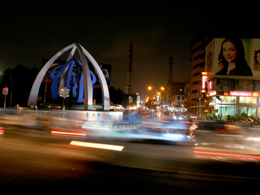 DIVINE INTERSECTION<br /> Allahwala Chowk, Karachi, Sindh<br />  The Allahwala Chowk stands resolutely at the intersection of Tariq Road and Shahrah-e-Quaideen, one of Karachi's busiest commercial hubs. Tariq Road is a shopper's paradise and is busy throughout the day and well into the night. <br />  Photographer:  Tahir Jamal