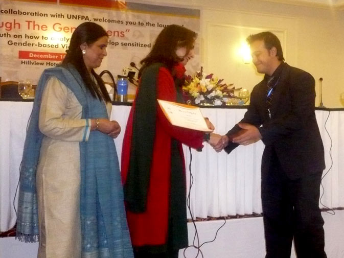 MNA Sherry Rehman hands out certificates to student members at the launch of ?Through the Gender lens? on Monday, December 10, 2010 in Islamabad.