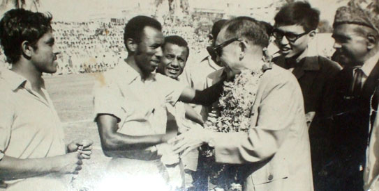 One of the stars of the 1960s, Abdul Ghafoor, shakes hands with the chief guest before a match. —File