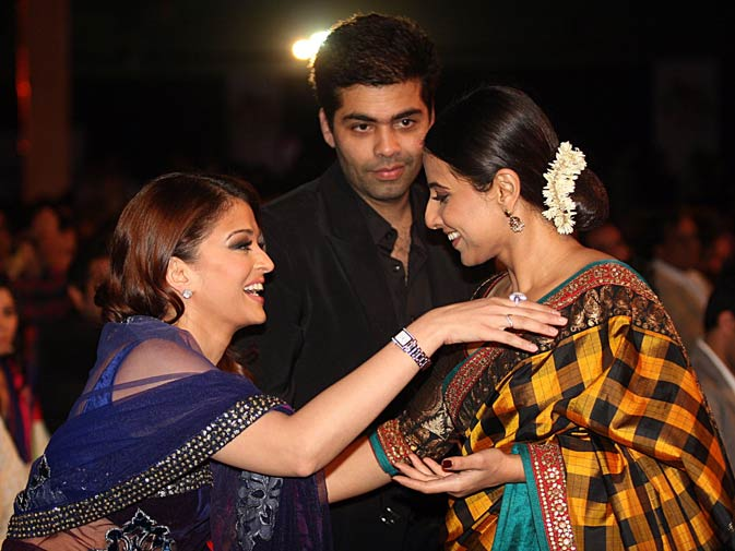 Indian Bollywood actress Aishwarya Rai Bachchan (L), director Karan Johar (C) and Vidya Balan. ? AFP
