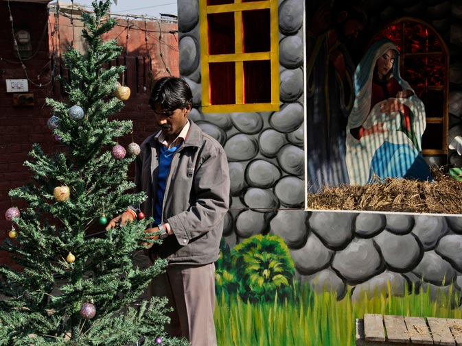 A Pakistani decorates St. Anthony's Church in preparation for Christmas, in Lahore. ? AP
