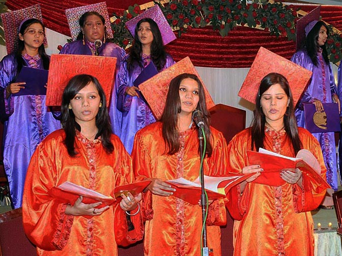 Christian girls sing during the preparation ceremony of Christmas in Rawalpindi. ? ONLINE