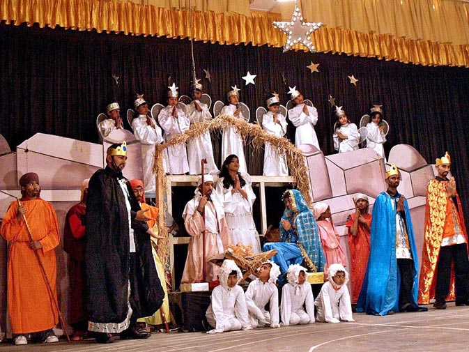 Students perform a tableau during a function to mark the Christmas celebration at Saint Bonaventure High School in Hyderabad. ? APP