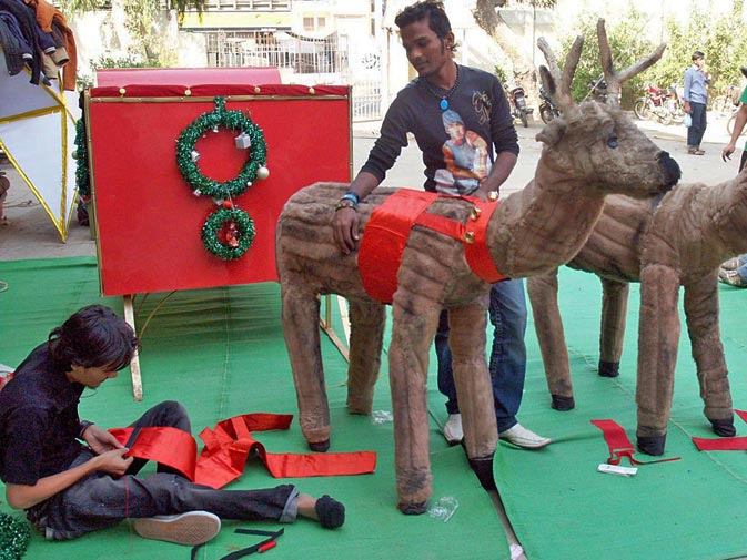 Men decorate reindeers ahead of Christmas in Karachi. ? ONLINE
