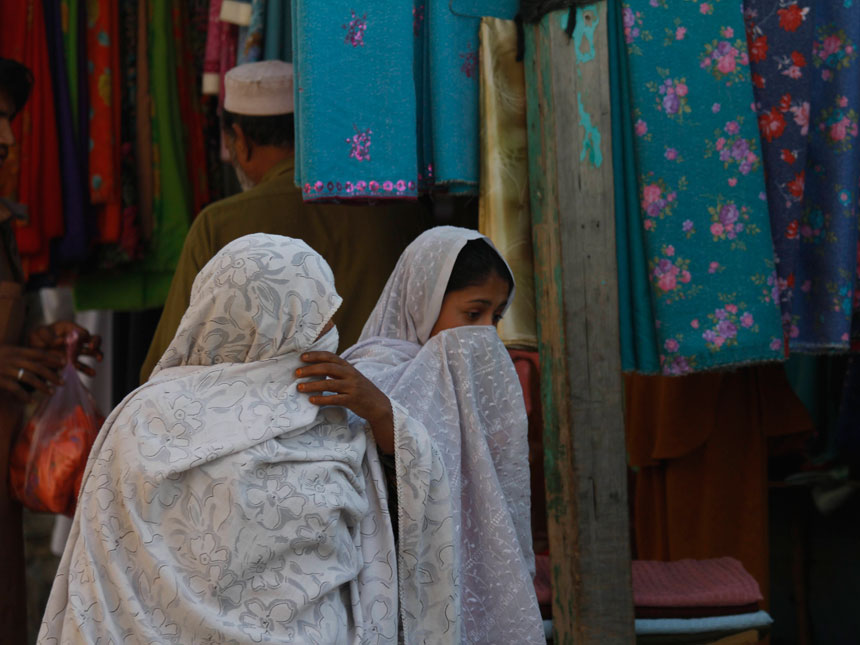 In this image taken on Nov. 30, 2010 Pakistani women from Swat Valley walk in a market in Mingora, Pakistan. More than a year after an army offensive that wrested control from the insurgents, veiled women have started venturing out to shop for food and clothes. ? AP