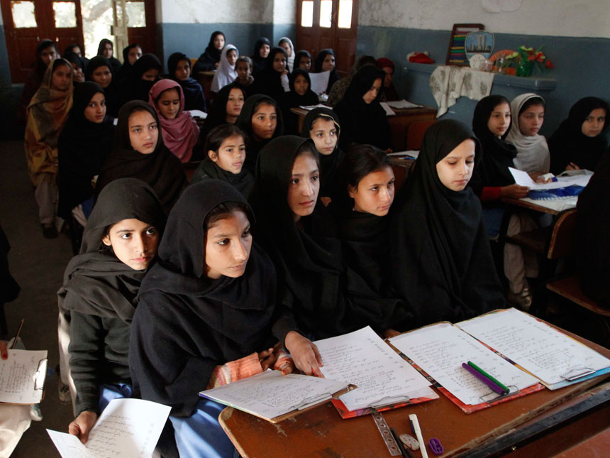 In this image taken on Dec. 1, 2010 girls attend school in  Mingora, Pakistan. More than a year after an army offensive that wrested   control from the insurgents, schoolgirls again flock giggling on the streets of Mingora. ? AP