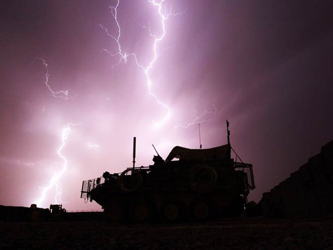 An armoured vehicle from the Centurion Company, 2-1 Infantry Battalion, 5/2 Stryker Brigade Combat Team is framed by a bolt of lightning during a storm at Combat Outpost Terminator in Maiwand District, Kandahar Province April 19, 2010. - Photo by Reuters.