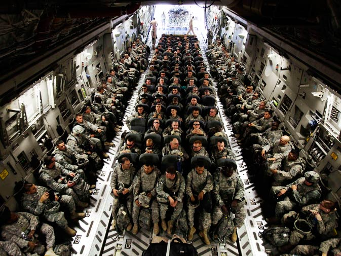 In this Nov. 30, 2010 file photo, members of 1st Brigade, 3rd Infantry Division, based at Fort Stewart, Ga., sit in the belly of a C-17 aircraft at Sather Air Base in Baghdad as they begin their journey home after a year in Iraq. - Photo by AP.