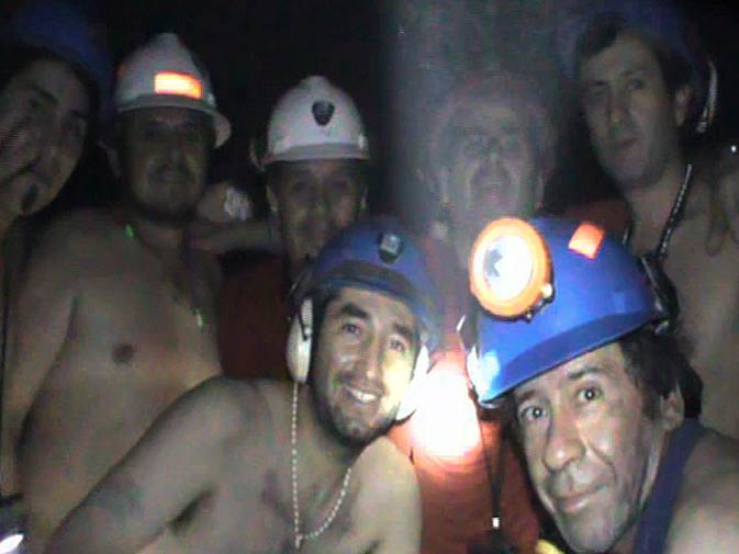 Trapped Chilean miners pose inside the San Jose Mine on September 17, 2010, near Copiapo, 800 km north of Santiago, Chile. - Photo by AFP.