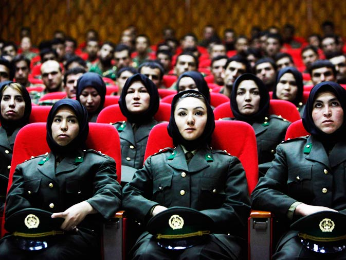 In this Sept. 23, 2010 file photo, newly trained female officers from the Afghan National Army take front seats as a new batch of officers attend their graduation ceremony at National Army's training center in Kabul, Afghanistan. - Photo by AP.