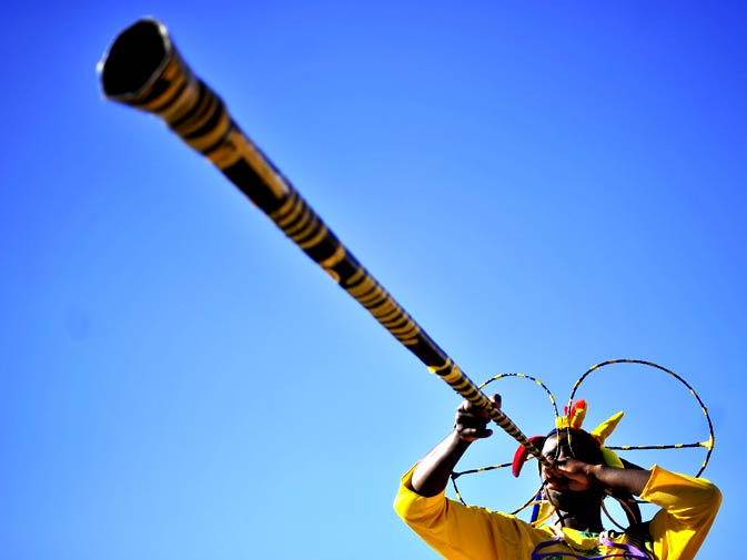 A football fan blows a vuvuzela horn on the first day of the 2010 World Cup in Cape Town, on June 11, 2010. Africa's first World Cup kicked off with hosts South Africa taking on Mexico at Soweto's showpiece Soccer City venue in front of 95,000 spectators, in suburban Johannesburg, followed by France and Uruguay in Cape Town. - Photo by AFP.