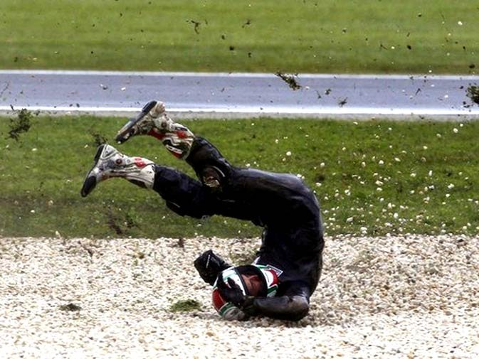 Amateur 125cc rider Jordan Zamora of Australia crashes during the first practice session of the Australian Grand Prix in Phillip Island near Melbourne October 15, 2010. - Photo by Reuters.