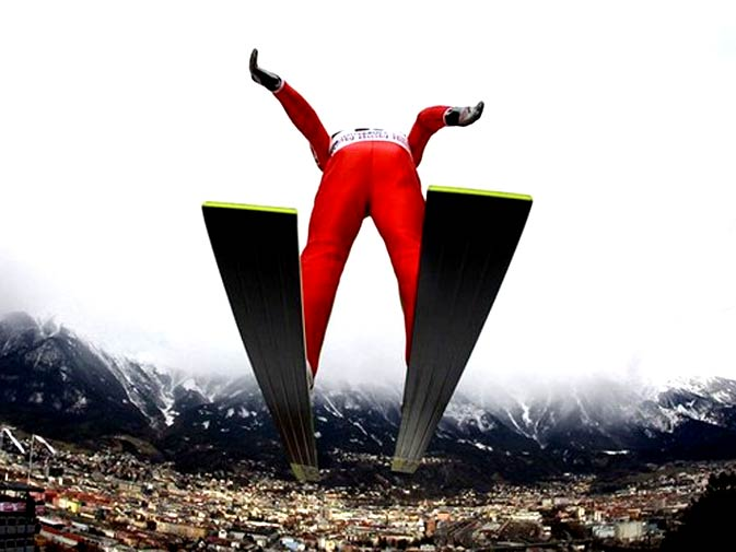 Russia's Dimitry Vassiliev soars through heavy snow clouds during the practice for the third event of the four-hills ski jumping tournament in Innsbruck, January 2, 2010. The practice and the qualification were cancelled due to heavy wind and snowfall. - Photo by Reuters.