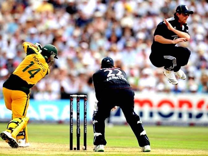 England's Paul Collingwood (R) leaps out of the way after Australia's Ricky Ponting hits out watched by Craig Kieswetter (C) during the third one-day international cricket match at Old Trafford cricket ground in Manchester June 27, 2010. - Photo by Reuters.