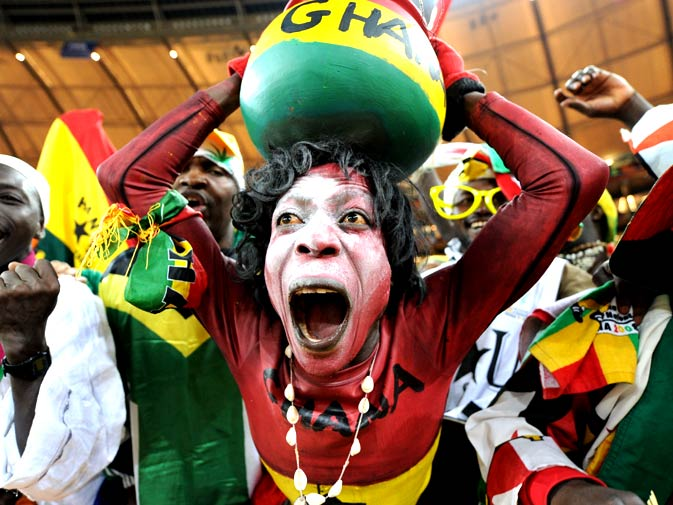 Supporters of Ghana's football squad cheer during the Group D, first round, 2010 World Cup football match Germany vs Ghana on June 23, 2010 at Soccer City stadium in Soweto, suburban Johannesburg. Germany won by 1-0. - Photo by AFP.