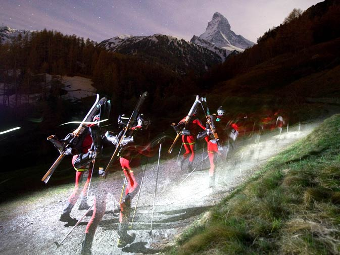 Racers run in front of the Matterhorn mountain as they leave the Zermatt ski resort during the start of the Glacier Patrol, a famous ski alpinism race early on April 22, 2010 in Zermatt. The Glacier Patrol (Patrouille des Glaciers) organized by the Swiss Army sees highly-experienced hiker-skiers trek across the Haute Route along the Swiss-Italian border from Zermatt to Verbier. The race covers 53km (31.8 miles) by foot and ski, with over 7000m gained and lost along the way. - Photo by AFP.