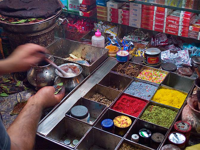 A paan can contain many varying ingredients with tastes ranging from sweet to bitter, all wrapped in a fragrant betel leaf and served to be eaten in one bite. Common paan ingredients include areca nuts, lime paste, and tobacco.