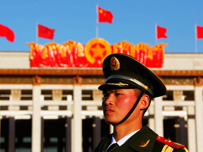 A paramilitary policeman stands guard at the Tiananmen Square in Beijing.