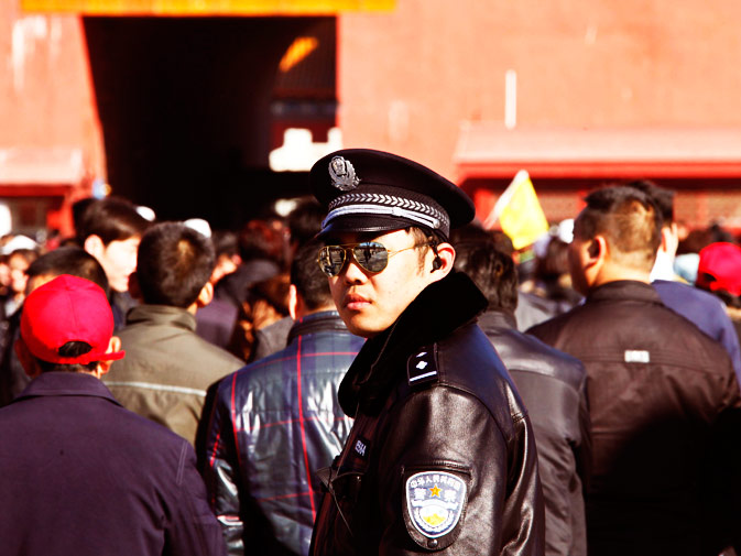 A policeman patrols at the Forbidden City.