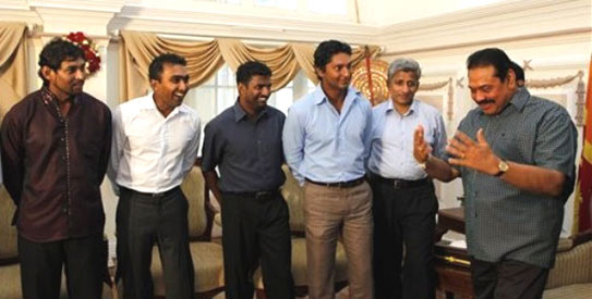 The Sri Lankan president met with the cricket team before the start of the ICC World Cup. —Photo by AP