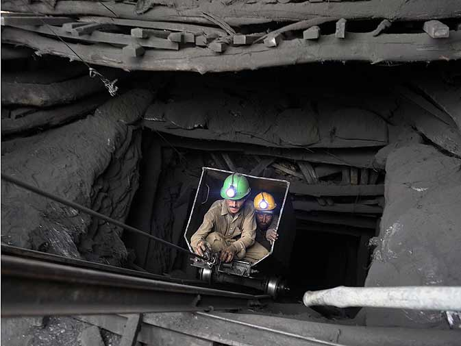 Pakistani miners emerge from a tunnel during the rescue operation at the coal mine.- AFP Photo