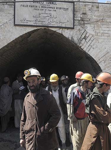 Pakistani rescue miners gather in front of a tunnel at the mine.- AFP Photo