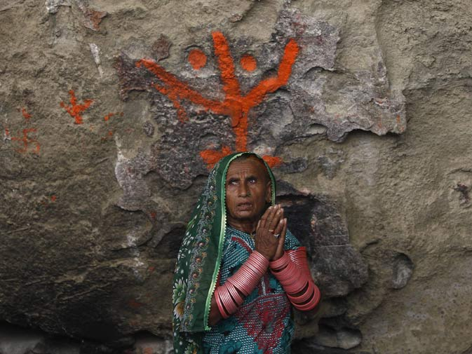 A devotee prays inside the Shri Hinglaj Mata Temple.