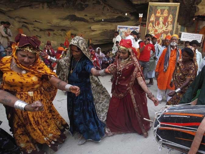 Devotees dance to drum beats.
