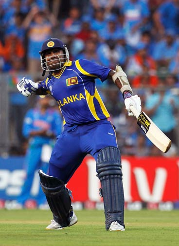Mahela Jayawardene celebrates scoring his century. ? Photo by Reuters