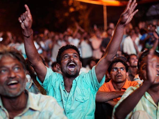 Indian fans cheer for their team. ? Photo by AP