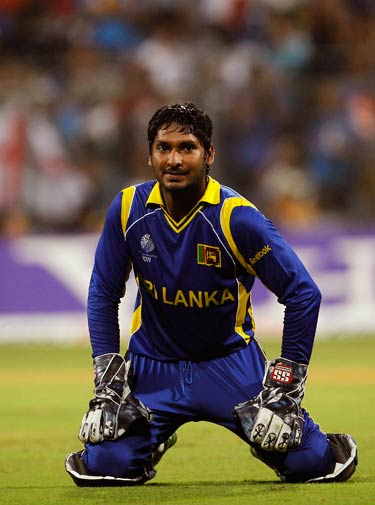 Kumar Sangakkara falls to his knees after he fails to stop a ball. ? Photo by AP