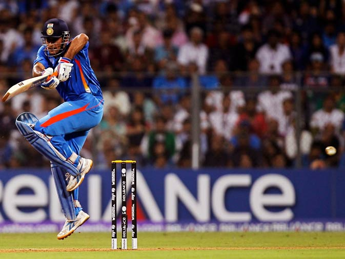 Mahendra Singh Dhoni hits a shot. ? Photo by Reuters