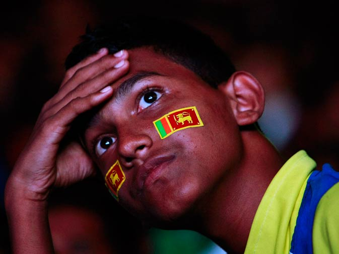A fan of the Sri Lanka team reacts as he watches the live match on TV. ? Photo by Reuters