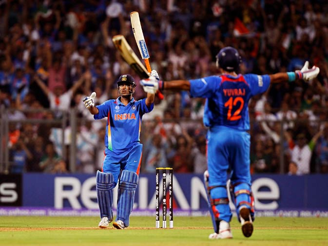 Mahendra Singh Dhoni (L) and Yuvraj Singh celebrate after their win over Sri Lanka. ? Photo by Reuters