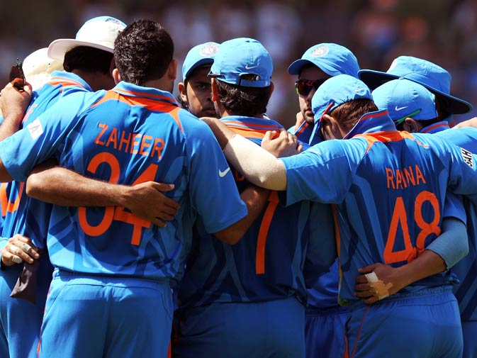 India's Captain Mahendra Singh Dhoni speaks to teammates as they form a huddle. ? Photo by AFP