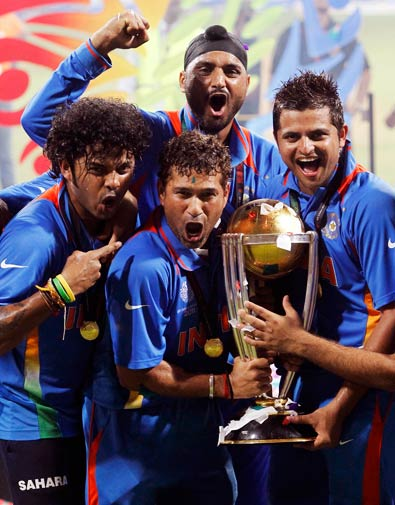 Shanthakumaran Sreesanth, Sachin Tendulkar, Harbhajan Singh (top) and Suresh Raina (L-R) celebrate with their trophy. ? Photo by Reuters