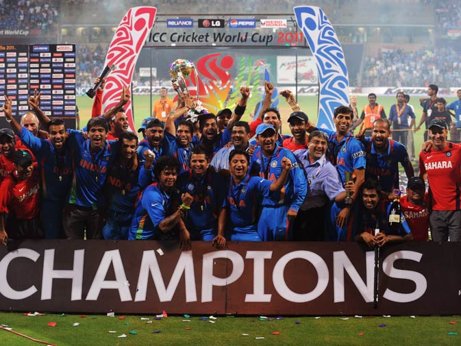 Indian cricketers pose with the trophy after victory in the Cricket World Cup 2011. ? Photo by AFP