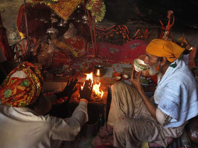 A devotee receives blessings in front of the deity at the Shri Hinglaj Mata Temple.