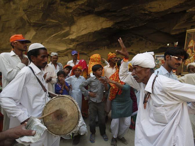 Devotees dance to drum beats to praise Shri Hinglaj Mata.