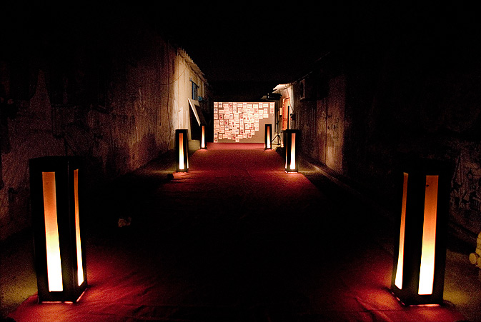The exhibition entrance, decorated with soft lights and a red carpet.