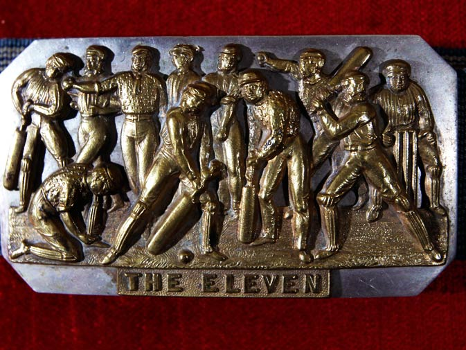 A belt-buckle circa 1868 that depicts English cricketers and worn by New York Knickerbockers baseball player Napoleon Bonaparte MacLaughlin, is seen in this picture.