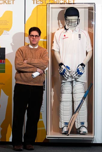 Tom Shieber poses with a test cricket batting form used by Andrew Flintoff.