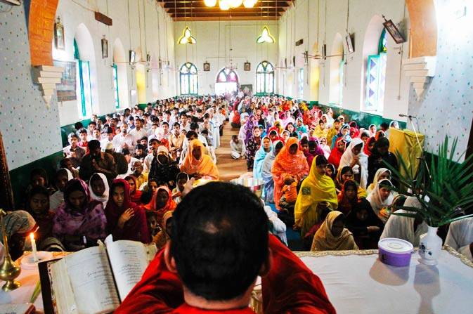 In this April 17, 2011 photo, Christians attend Palm Sunday service at a church in Khushpur village near Faisalabad, Pakistan. - Photo by AP.