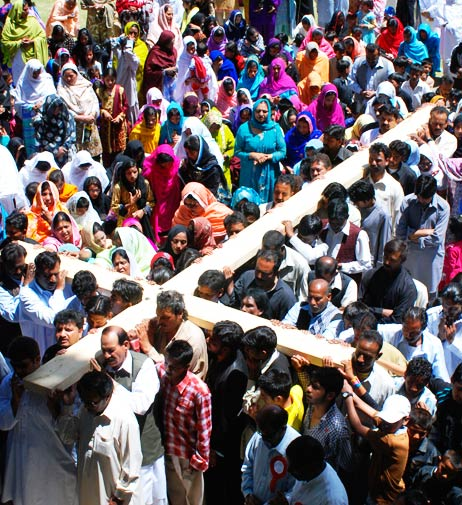 Christians carry a cross during their congregation on Good Friday in Quetta. - Photo by AP.