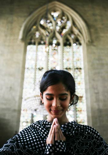 A Christian girl prays on Good Friday at a local church in Karachi. - Photo by AP.