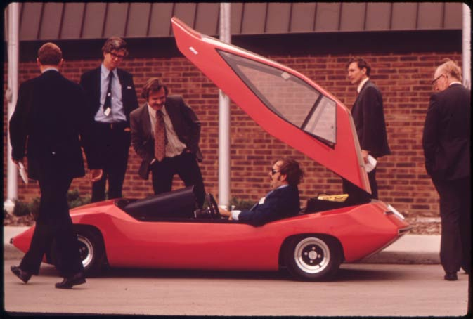 In this Oct. 1973 photo, participants check out the Exide Battery Sundancer, an early experimental electric car at the First Symposium on Low Pollution Power Systems Development in Ann Arbor, Mich.